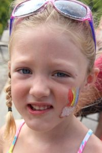 young girl with face paint at 2nd annual community celebration
