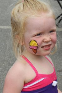 young girl with ice cream face paint at 2nd annual community celebration