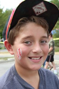 smiling boy at 2nd annual community celebration