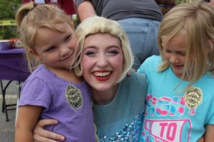 elsa and two young girls at 2nd annual community celebration