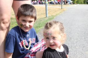 two young children with face paint at 2nd annual community celebration