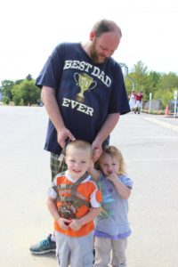 dad with two young children at 2nd annual community celebration