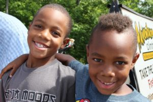 two smiling boys at 2nd annual community celebration