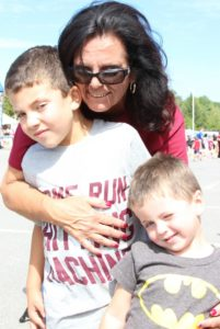 woman with two young boys at 2nd annual community celebration