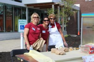 three women volunteers at 2nd annual community celebration