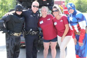 captain america batman police officer and two women at 2nd annual community celebration
