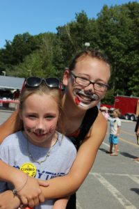 two girls with face paint at 2nd annual community celebration