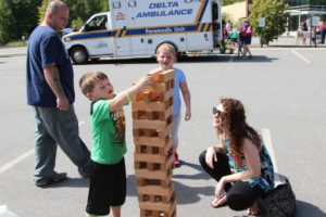 kids playing outdoor jenga at 2nd annual community celebration