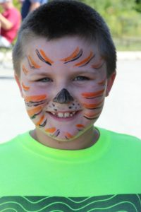 boy with tiger face paint at 2nd annual community celebration