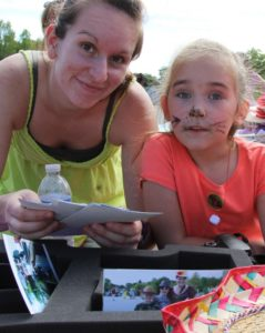 woman and young girl with cat face paint at 2nd annual community celebration