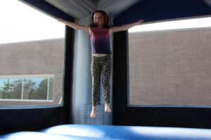 young girl in bounce house at 2nd annual community celebration