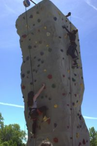 kids climbing the climbing wall at 3rd annual community celebration