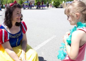 snow white talking to young girl at 3rd annual community celebration