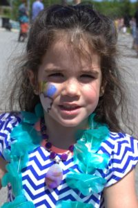 young girl with face paint at 3rd annual community celebration