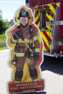 kid in waterville fire department cutout at 3rd annual community celebration
