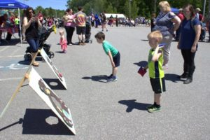 kids playing bean bag toss at 3rd annual community celebration