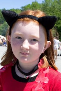 girl in cat ears at 3rd annual community celebration
