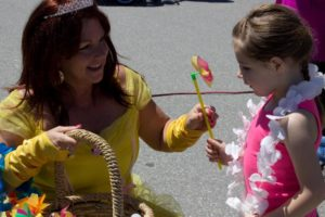belle handing out pinwheel at 3rd annual community celebration