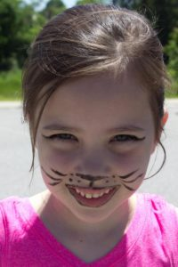 young girl with cat face paint at 3rd annual community celebration