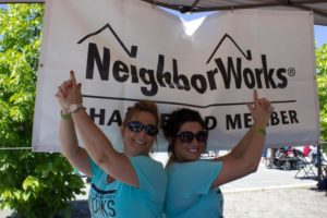 two neighborworks members with hand guns at 3rd annual community celebration
