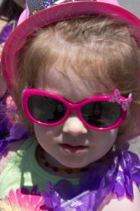 young girl in sunglasses at 3rd annual community celebration