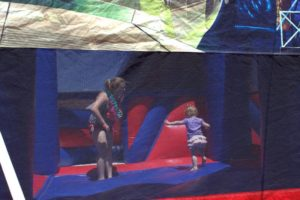 young kids in bounce house at 3rd annual community celebration