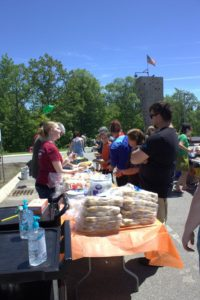 people handing out food at 3rd annual community celebration