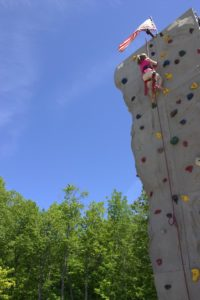 girl on climbing wall at 3rd annual community celebration