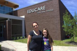 woman and girl in front of educare building at 3rd annual community celebration