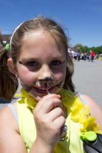 young girl in face paint at 3rd annual community celebration