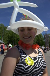 girl in balloon hat at 3rd annual community celebration
