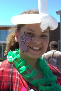 girl with face paint at 3rd annual community celebration