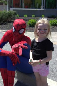 spiderman and young girl at 3rd annual community celebration