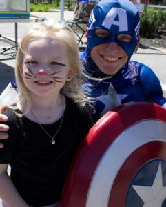 captain america and young girl at 3rd annual community celebration