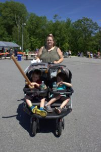 kids in stroller at 3rd annual community celebration