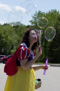 snow white blowing bubbles at 3rd annual community celebration