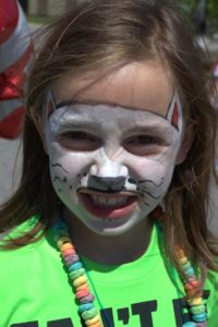 girl with cat face paint at 3rd annual community celebration