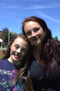 woman and girl with cat face paint at 3rd annual community celebration