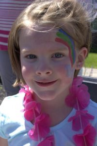 young girl with facepaint at 3rd annual community celebration