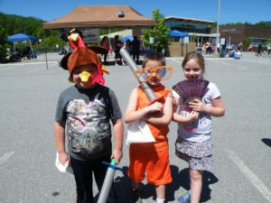 children with foam swords and fan enjoying 3rd annual community celebration