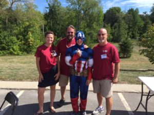captain america with three volunteers at 2nd annual community celebration
