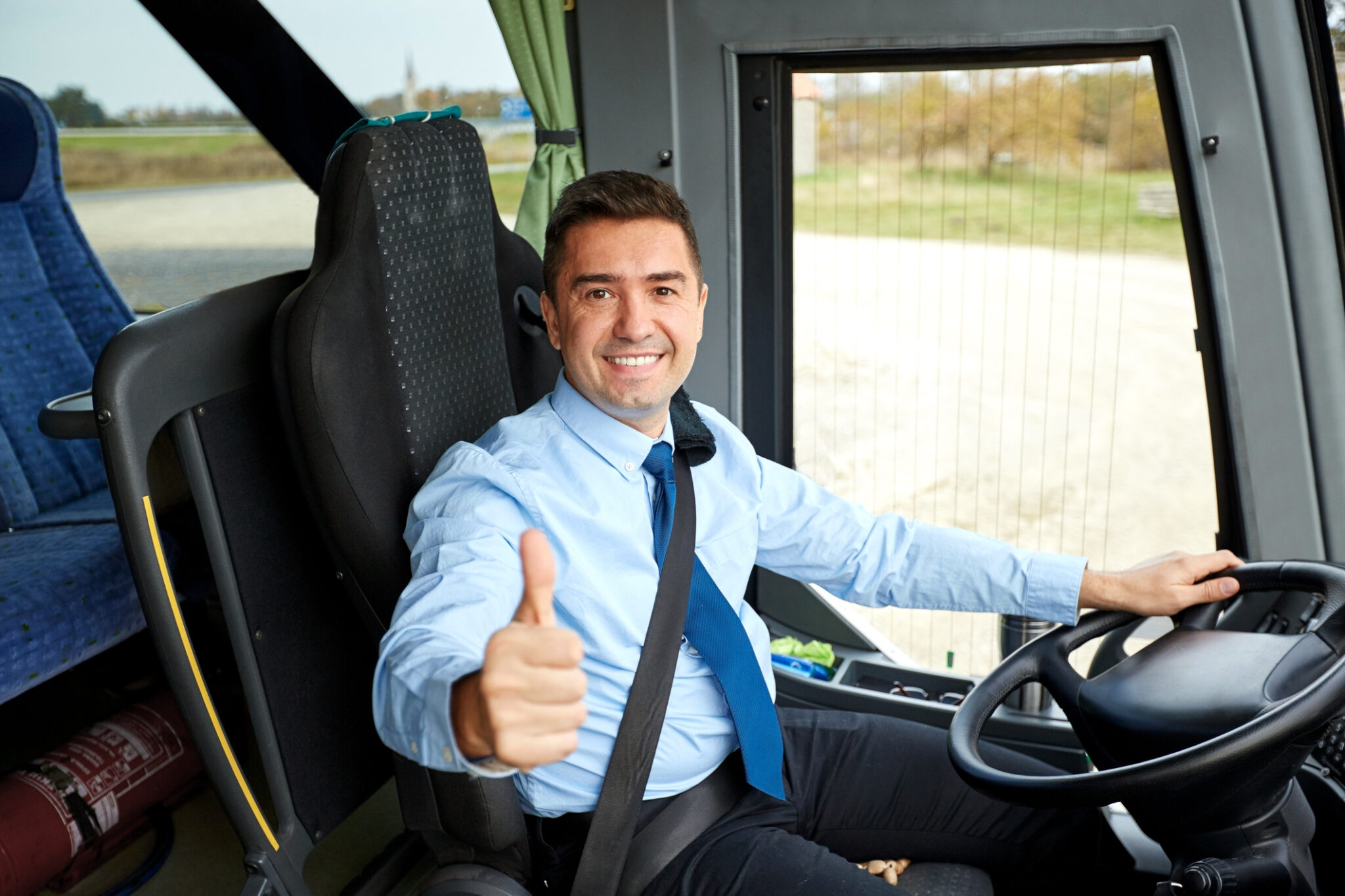 happy driver driving intercity bus and snowing thumbs up