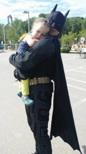 batman hugging a girl at 2nd annual community celebration