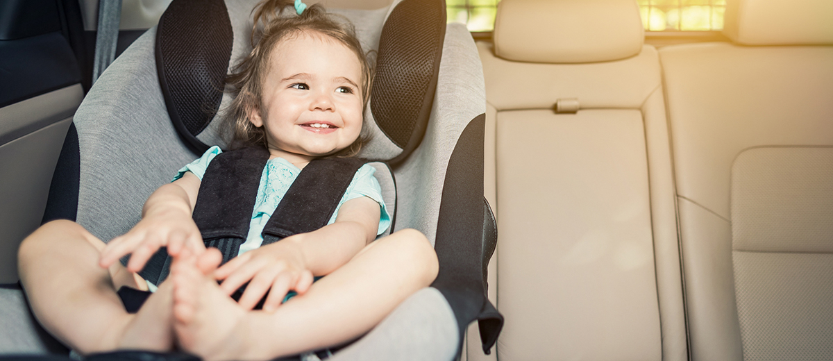 baby girl in car seat in maine