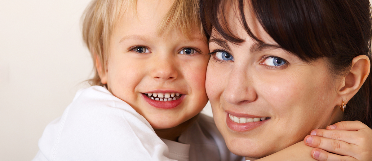 happy child hugging his mom