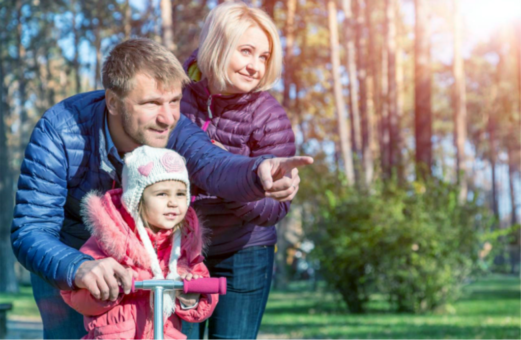 Mom, dad and child outdoors